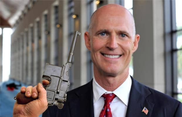 Governor Scott demonstrates new law.