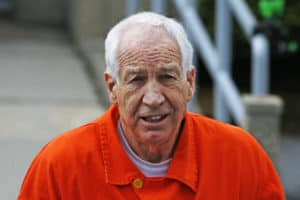 Sadusky wearing prison orange.