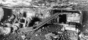Photo of two men in a coal mine