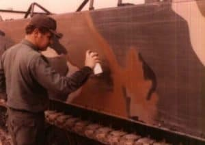 soldier paints a tank