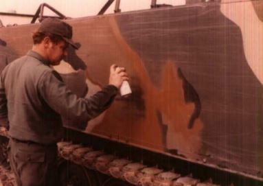 soldier paints a tank
